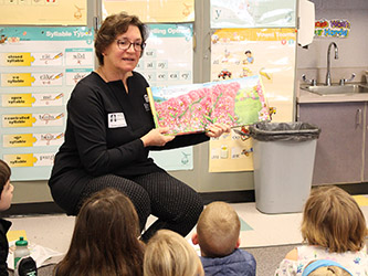 Joy Keller-Brown reads to SES students